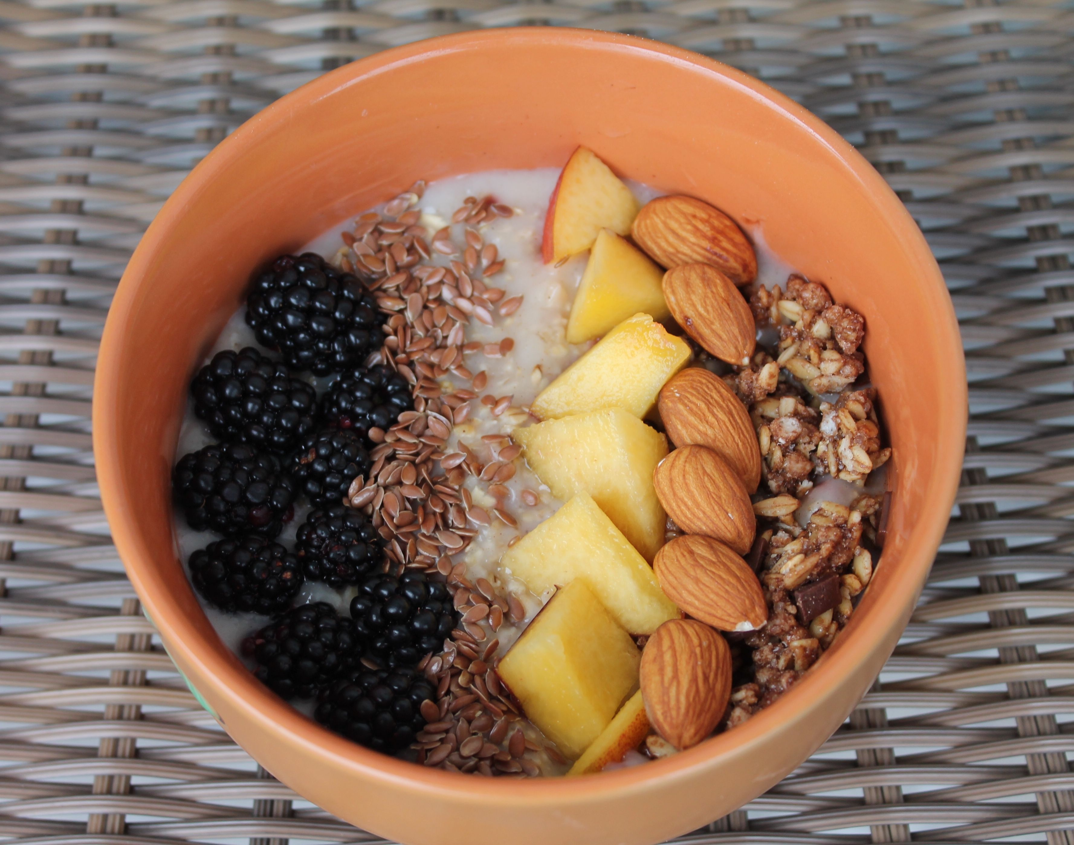 Vanilla oatmeal with blackberries, flax seeds, nectarines, almonds and chocolate granola