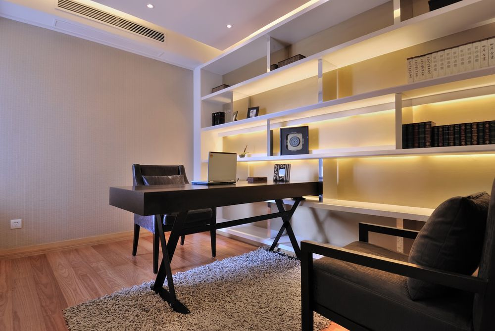 Modern Home Office With Small Wood Desk, Wood Floor And Bookshelves With  Back Lighting