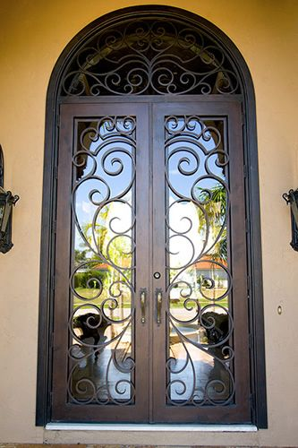 Custom iron front door, not a fan of the color of the house, maybe ...
