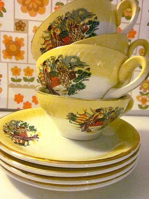 vintage yellow tea cups and saucers