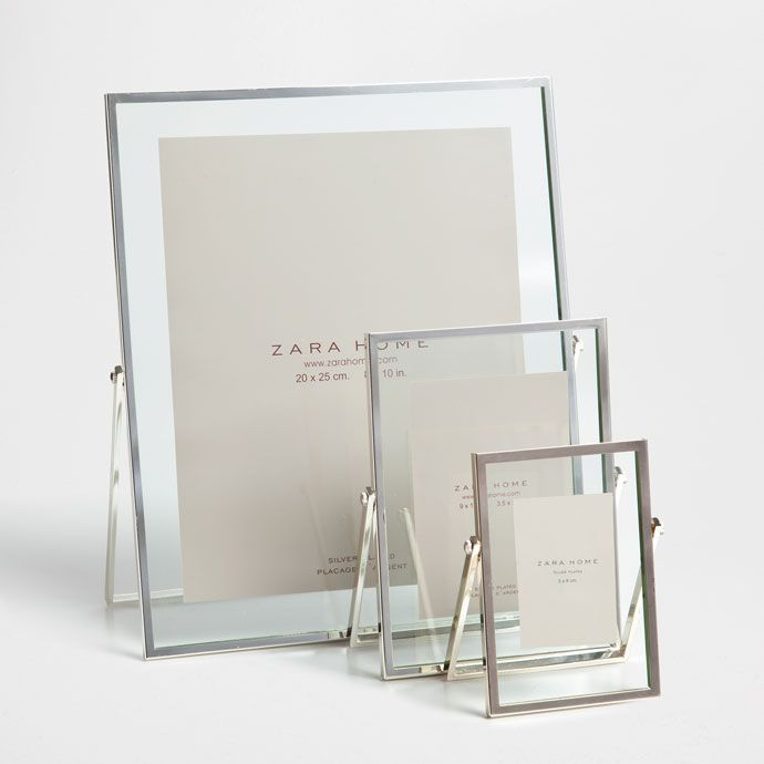 Photo holder with thin metallic frame.<br>Each size is sold ...