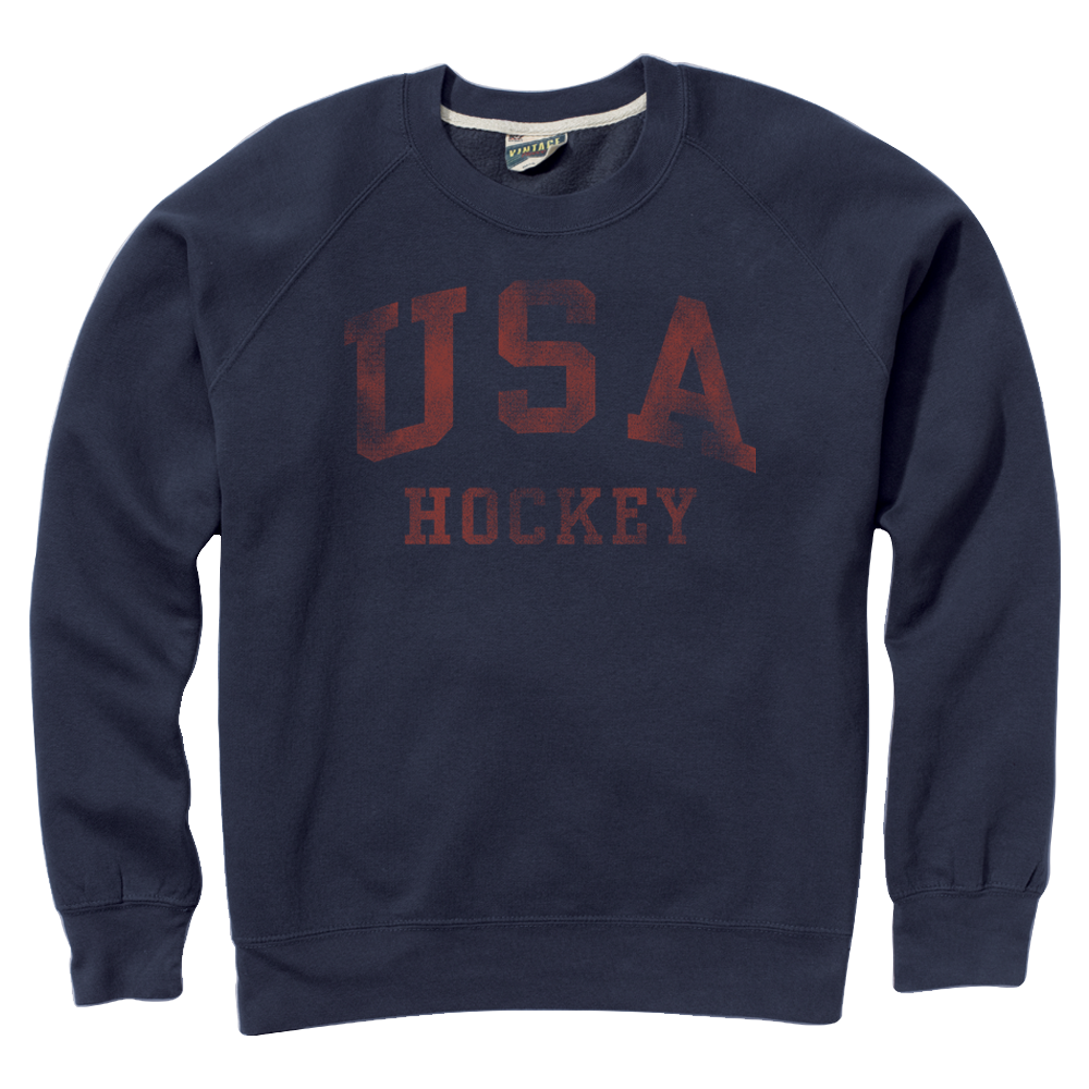 9e2400df0 This vintage classic fit crew-neck sweater is decorated with the USA Hockey  block lettering in the front and Arc   Star logo in the back.