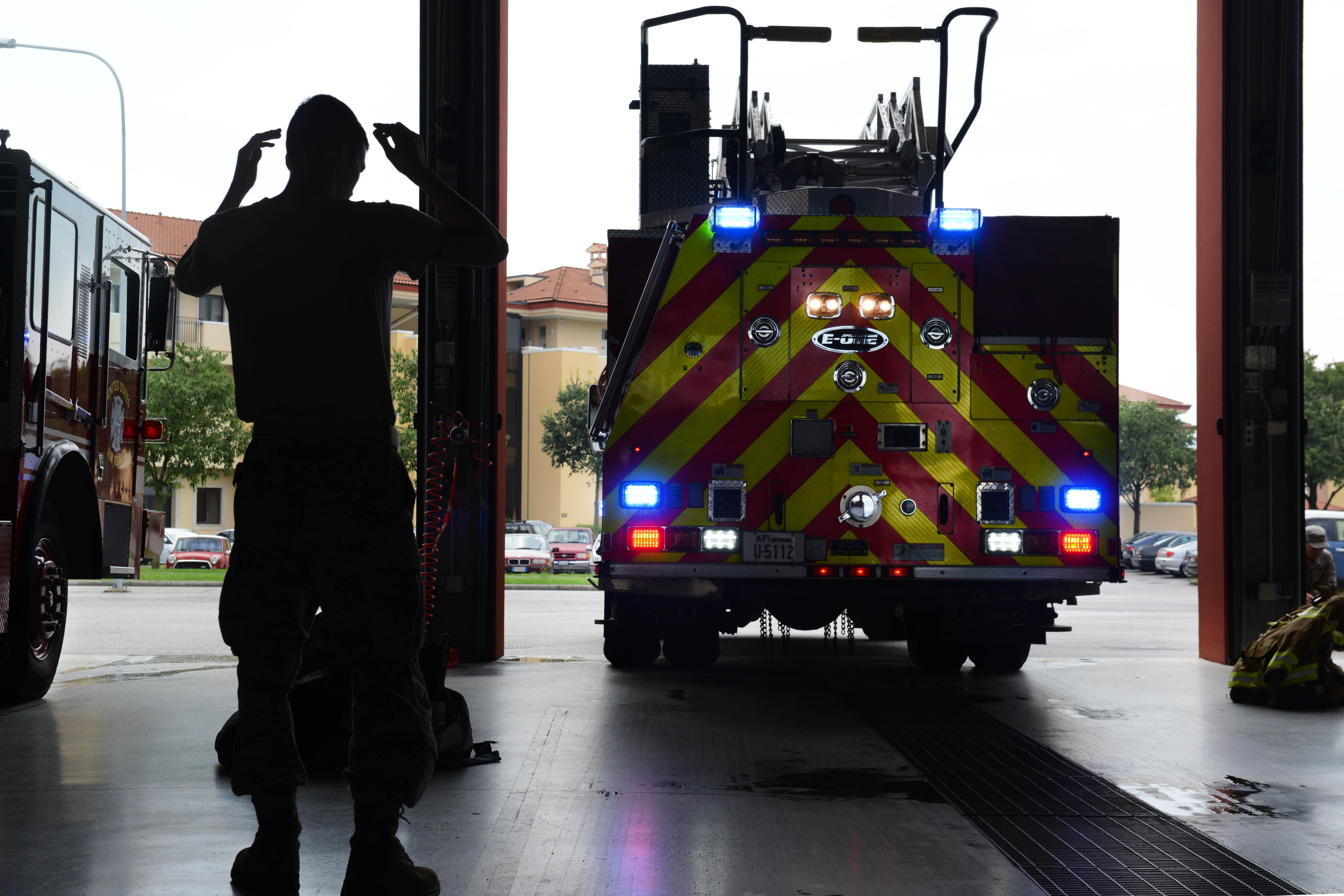 During an operations check, Airman 1st Class Joseph Cappel, 31st Civil Engineer Squadron firefighter, guides a fire truck into the Aviano firehouse, July 29, 2014, at Aviano Air Base, Italy. At the beginning of a 24-hour shift, firefighters conduct operations checks on the trucks to always be prepared for when they receive an emergency call. (U.S. Air Force photo/Airman 1st Class Ryan Conroy)