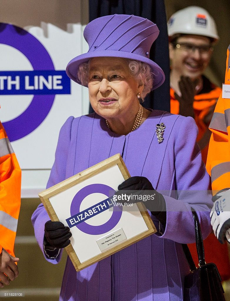 Queen Elizabeth holds a commemorative plaque given to her by Crossrail workers after she formally unveiled the new roundel for the Crossrail line which is still under construction on February 23, 2016 in London, England. The Queen unveiled the new roundel for the Crossrail line that is to be renamed the 'Elizabeth line' from December 2018 when the line opens to passengers in the capital. (Photo by Richard Pohle - WPA Pool/Getty Images)
