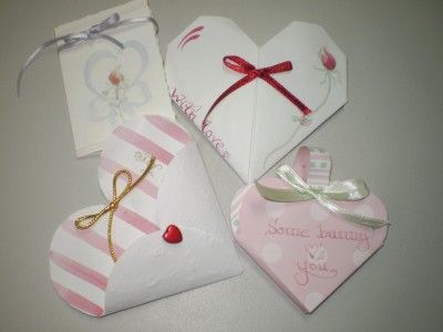 These are made from paper and I make about 50 or so, for my co-workers each Valentine's Day and Easter (also Christmas not shown) with a chocolate treat included.