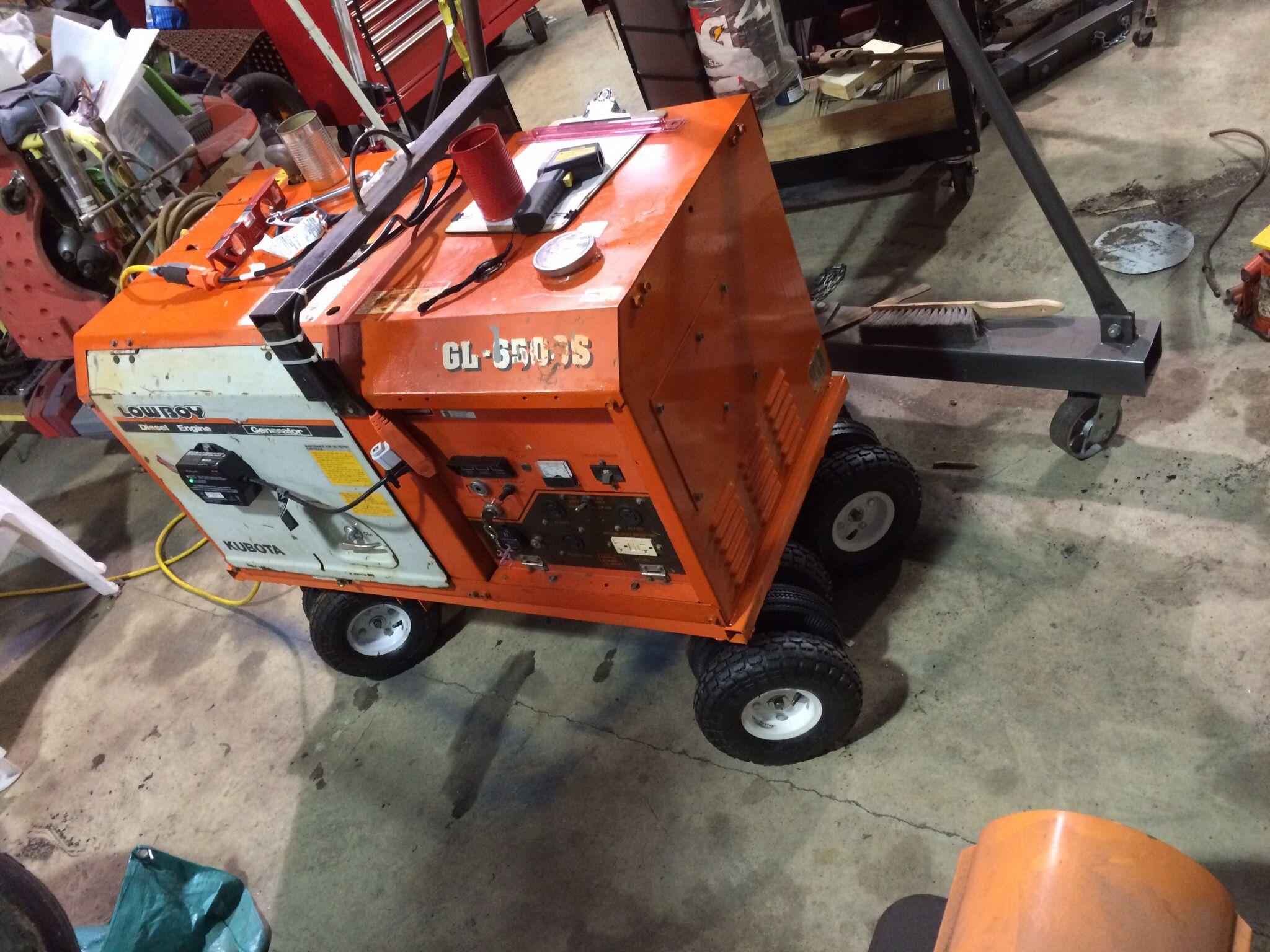 Kubota sel generator cart with triple bogey wheels to roll over