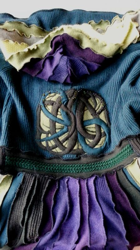 SWEATER COATS - La Tailleuse This is a custom made sweatercoat in purple and greens, with a tree of life applique on the back, long rows of vintage belly dance buttons on te sleeves, a big round hood and a double closure .. latailleuse.weebly.com