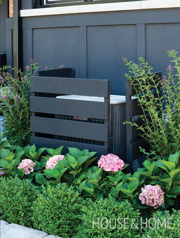 we love how designer sarah hartill built simple slatted walls to hide the air conditioning unit in her front garden photographer donna griffith - Best Air Conditioning Units