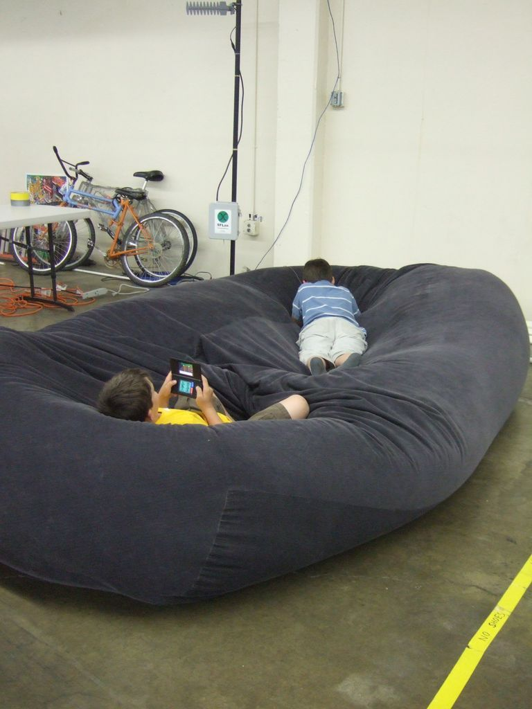 Hmmm... D.C. has been asking for a bean bag. I wonder if I could use packing peanuts (reduce! reuse! recycle!) and make it just a little larger then a regular bean bag.