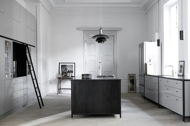 soft grey cabinets, brass fixtures, black counters & trim; cabinet ladder;  heritage apartment [Kobenhavns Mobelsnedkeri]
