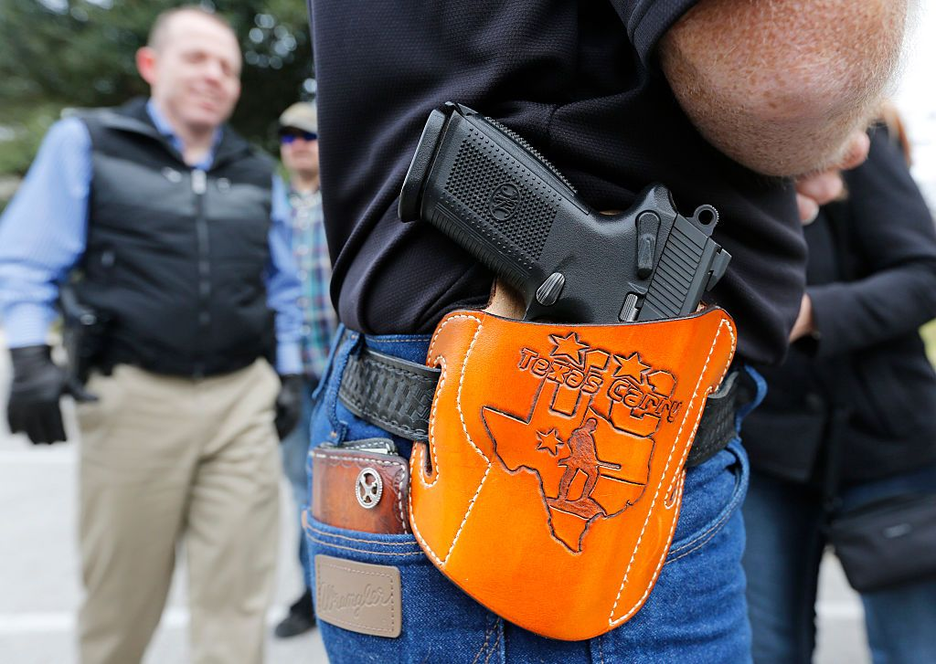 AUSTIN, TX - JANUARY 1: On January 1, 2016, the open carry law took effect in Texas, and 2nd Amendment activists held an open carry rally at the Texas state capitol on January 1, 2016 in Austin, Texas. (Photo by Erich Schlegel/Getty Images)