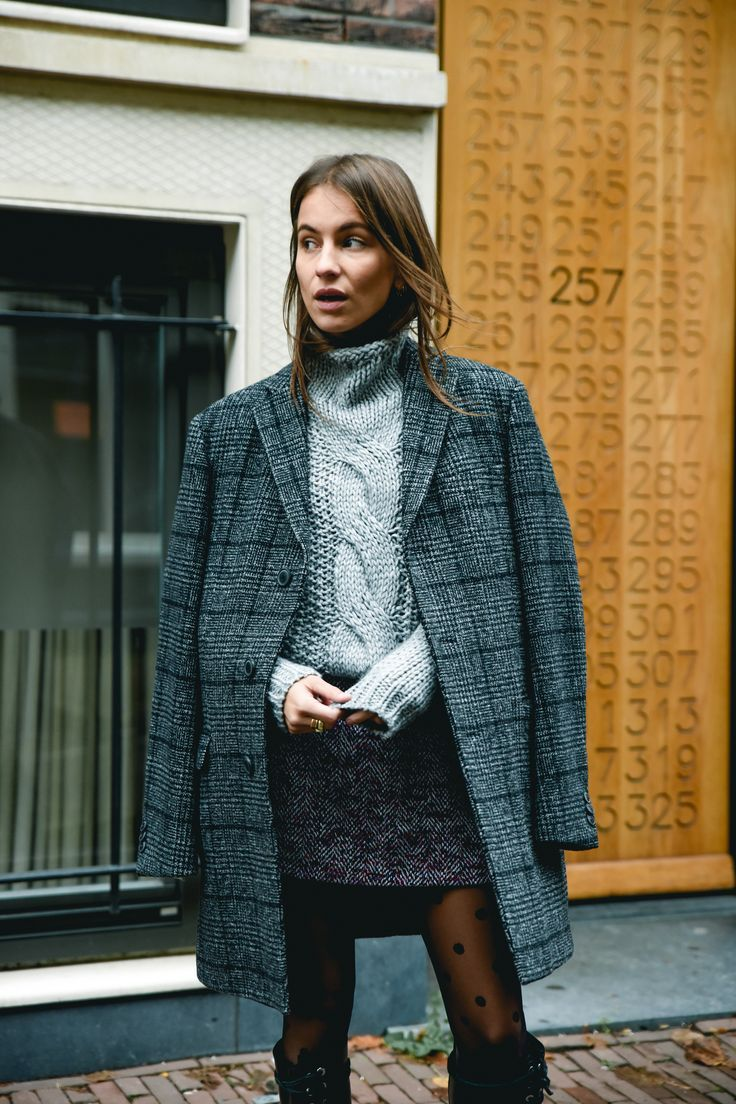 Long plaid coat, cable knit turtleneck sweater, mini skirt and polka dot sheer tights