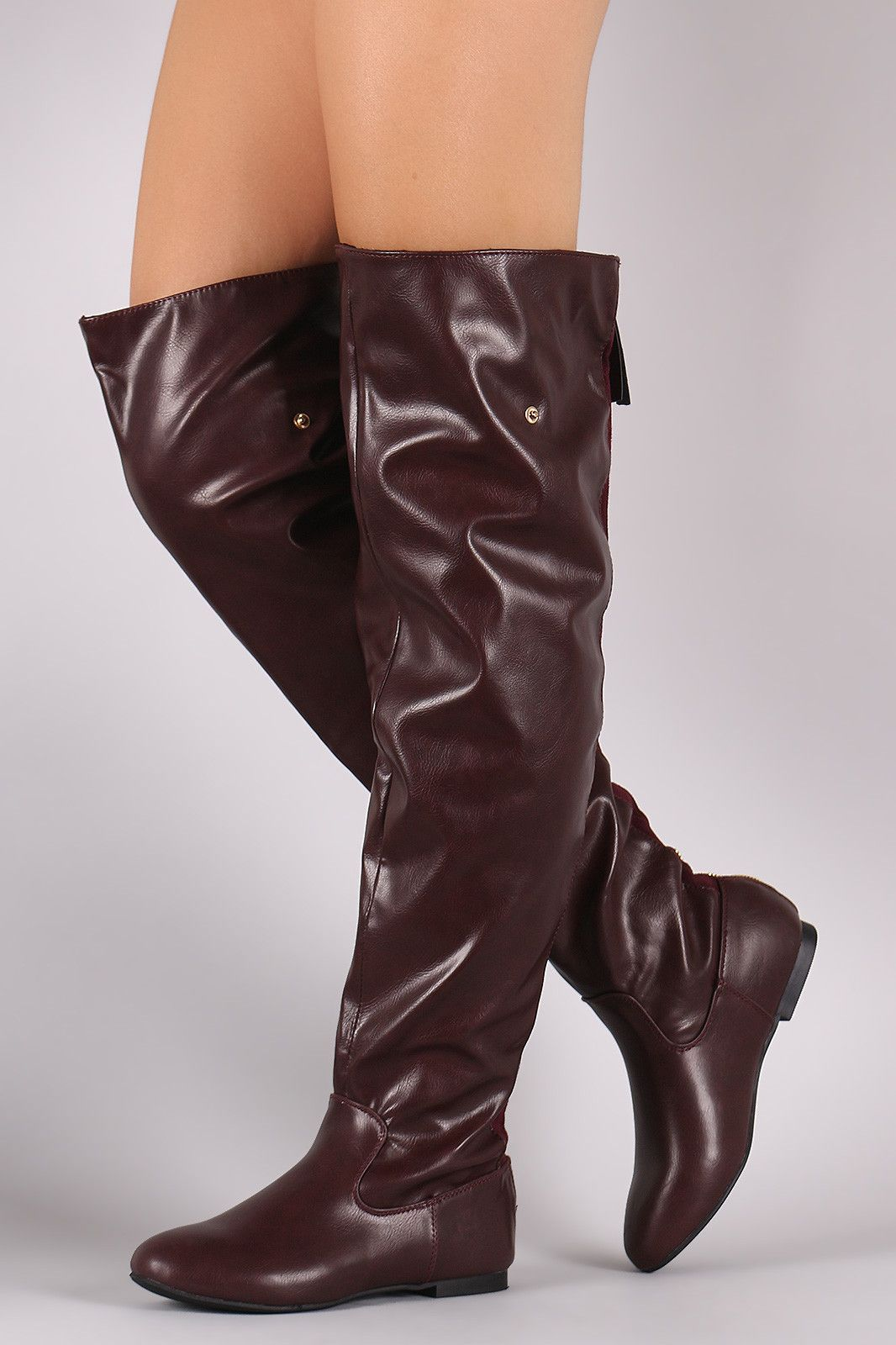 """These  over the knee boots ,feature a slouchy silhouette with a full adjustable back zipper. Designed with side snap buttons for an optional fold over cuff. Cuff area is vegan suede material. Lightly padded lining.Material: Vegan Leather (man-made)Sole: RubberMeasurement Heel Height: 0.3"""" (approx) 