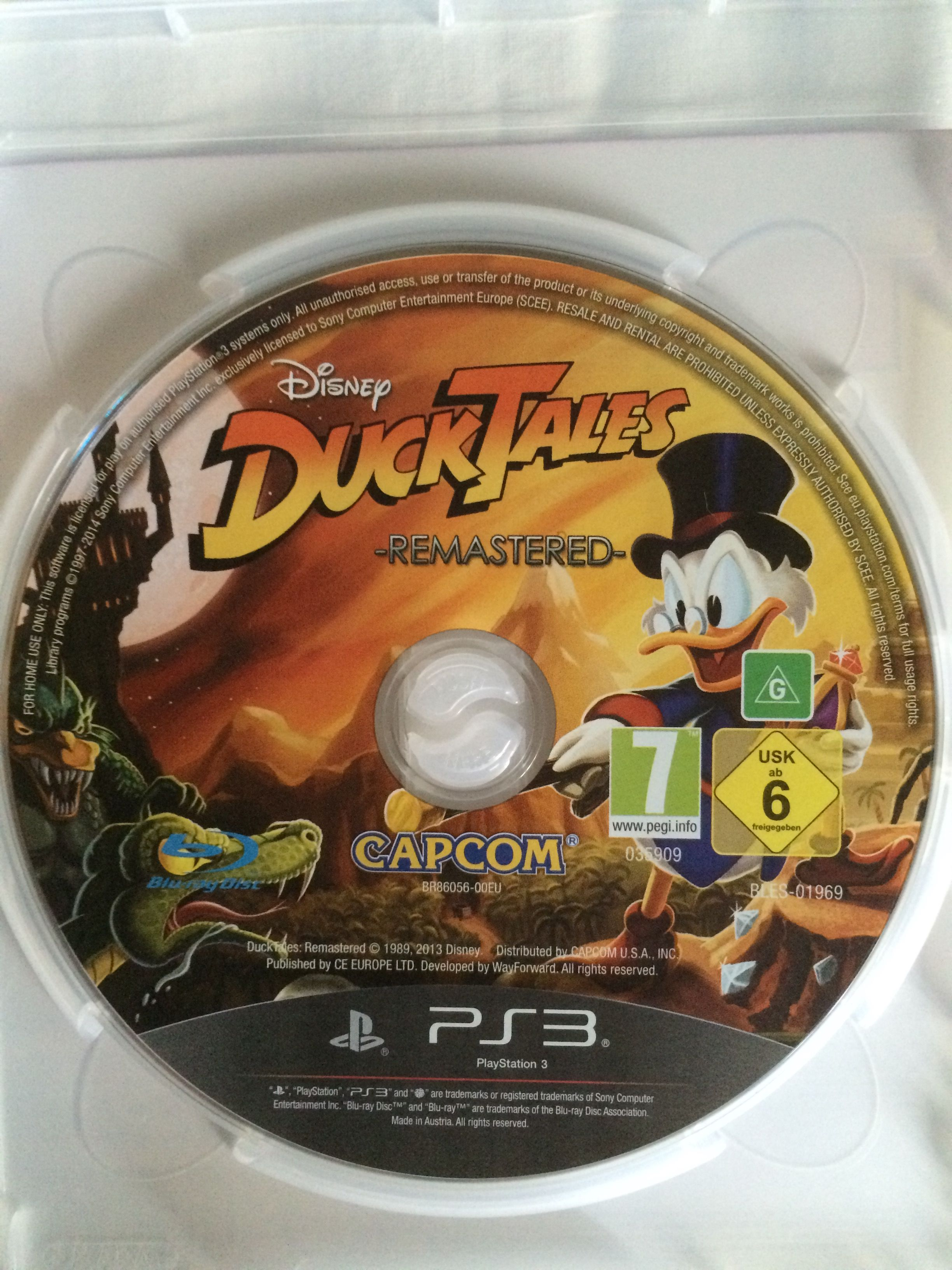 DuckTales Remastered game disc. | DuckTales Remastered "|2448|3264|?|en|2|934adbd979e3983db29f920e4300c44f|False|UNLIKELY|0.37603670358657837