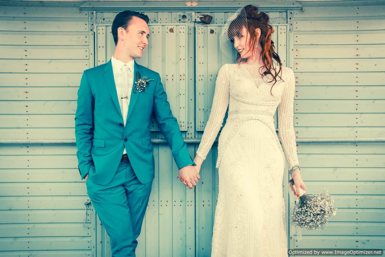 Me and my groom posing by a beach hut groom in turquoise paul smith