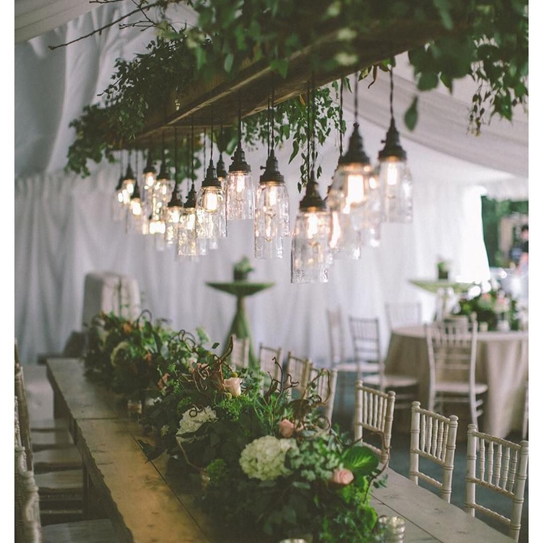 Id like floral hanging over table from the rafters and i like the low hanging edison bulbs strung from a floral chandelier industrial rustic arubaitofo Gallery