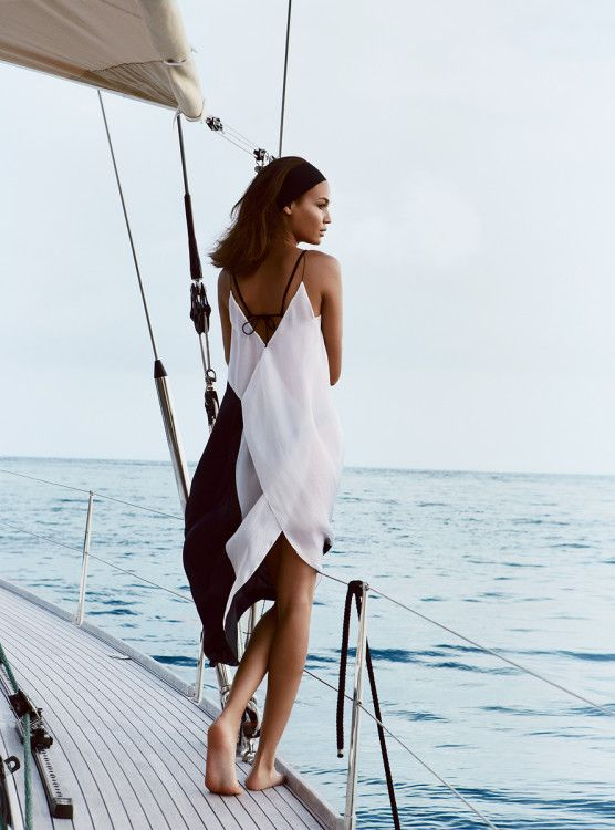 'Smooth Sailing' photograph of Joan Smalls in St Barth by Patrick Demarchelier for Vogue 2013 - Narciso Rodriguez silk dress & Eres bikini top