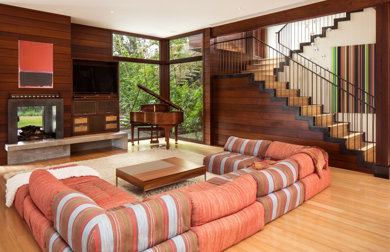 Colourful living room with a majestic wooden staircase