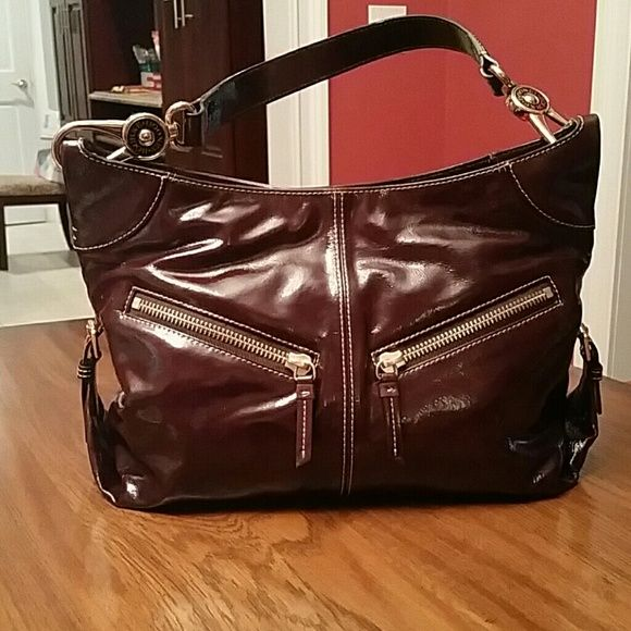 Dooney & Burke choco brown handbag Cute chocolate brown handbag, great for the upcoming fall. Small wear/tear on two of the corners as shown in picture. Adjustable side straps to open up and give more room ! Dooney & Bourke Bags