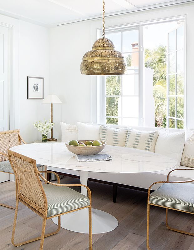Delightful Transitional Dining Space Oval Tulip Table Brass Perforated Chandelier