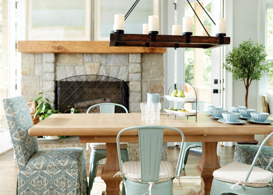 The rustic wood frame and riveted black metal strapping for Ballard designs dining room
