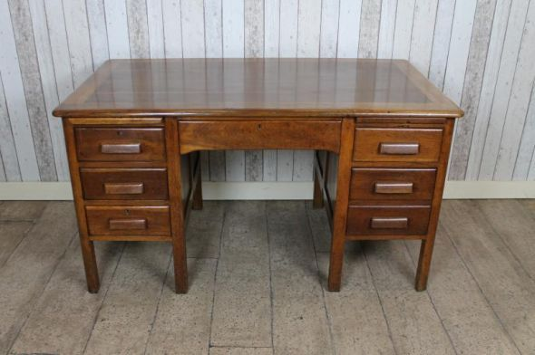 This 1940s/1950s Vintage Oak Office Desk Features A Twin Pedestal Design  With Multiple Drawers