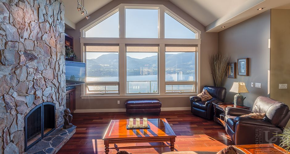 Plain Vaulted Ceiling In Great Room Windows Matching The Vaulted Ceilings Allow For Floor To Ceiling Views Vaulted Ceiling Living Room Home Decor Great Rooms