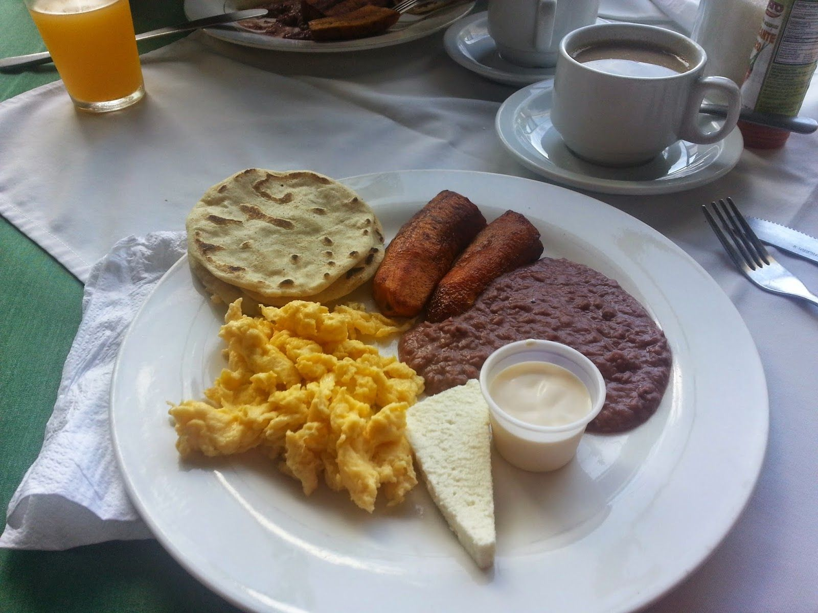El Salvador food.  Breakfast in El Salvador, typical breakfast consists of Eggs, beans, cream, plantains  #breakfast #elsalvador #toursinelsalvador #elsalvadorfood El Salvador food.  Breakfast in El Salvador, typical breakfast consists of Eggs, beans, cream, plantains  #breakfast #elsalvador #toursinelsalvador #elsalvadorfood
