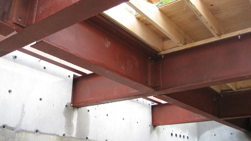 Steel Floor Beams Over Garage Welded Connections Connected To Concrete Wall Joists Above