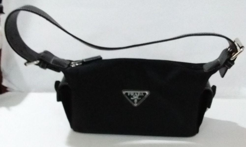9e0144733ceb Prada Nylon Black Bag Leather Straps White Stitching Silver Buckles Clasps  Ziper  prada  money  shoulderbag  carrying  wearing