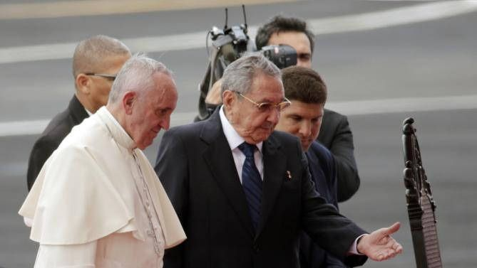 https://flic.kr/p/yPwbx7 | Cuba Pope | Pope Francis is escorted to a chair by Cuba's President Raul Castro during his arrival ceremony at the airport in Havana, Cuba, Saturday, Sept. 19, 2015. Pope Francis begins a 10-day trip to Cuba and the United States on Saturday, embarking on his first trip to the onetime Cold War foes after helping to nudge forward their historic rapprochement. (AP Photo/Ramon Espinosa)