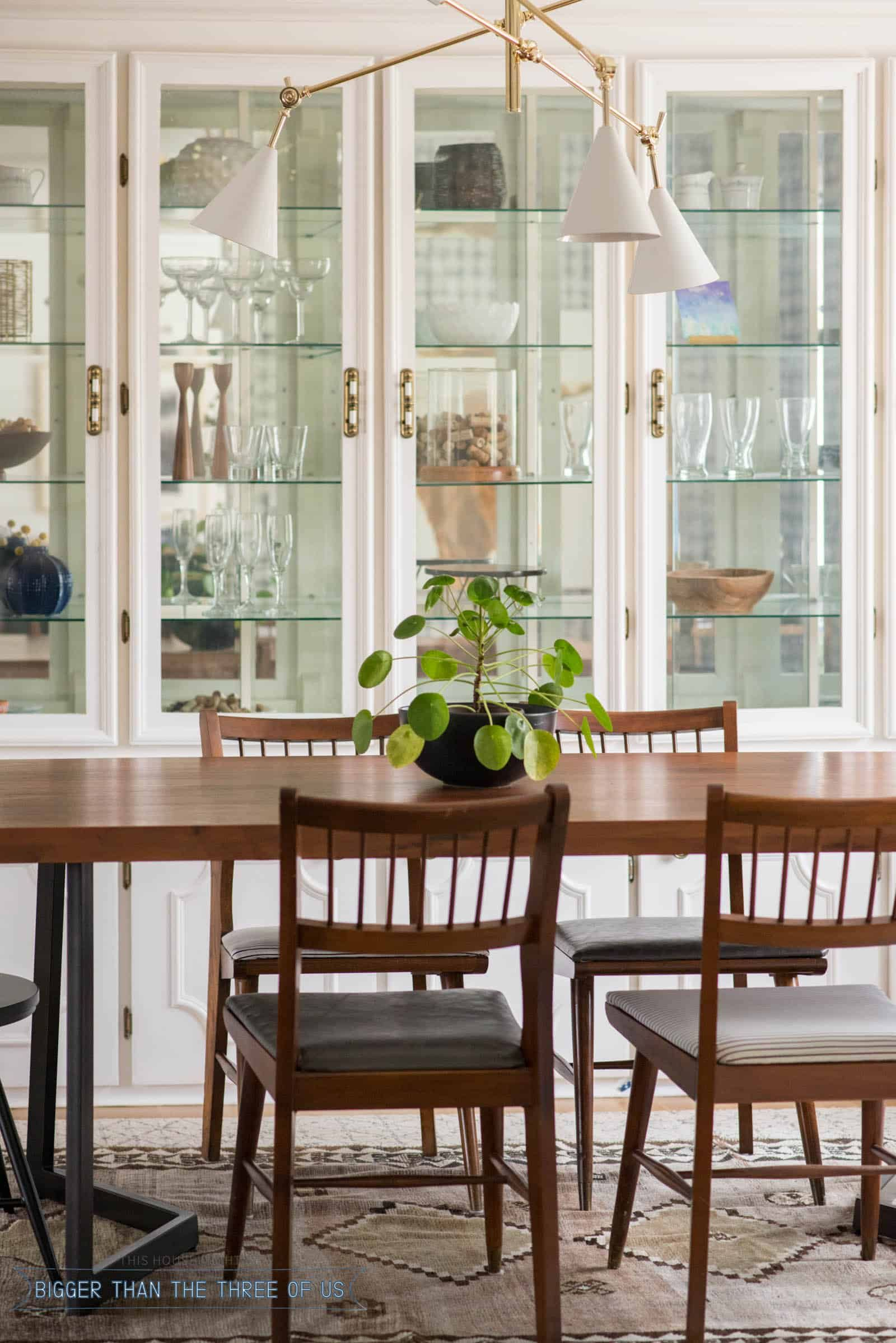 Leather Upholstered Midcentury Chairs With Black Spindle Chairs In Dining Room Formal Dining Room Furniture Dining Room Updates Scandi Dining Room