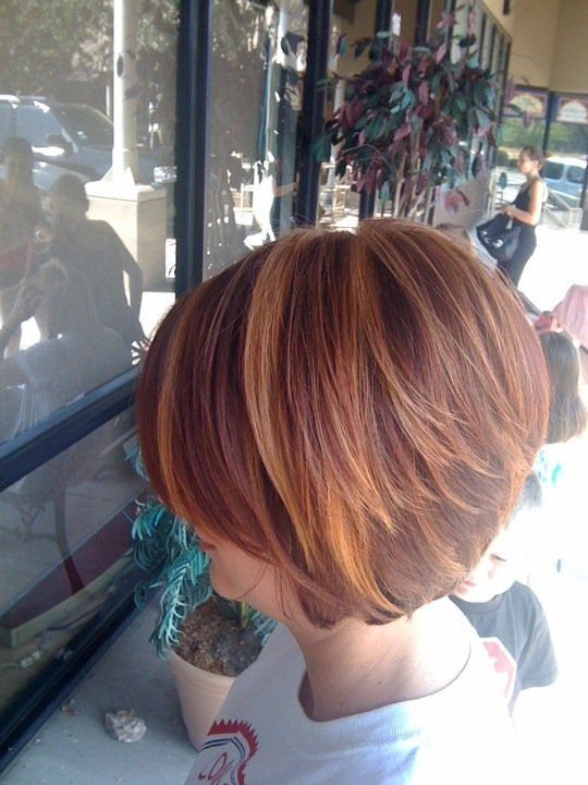 Red hi-lighted stacked bob. I love the color and the cut!
