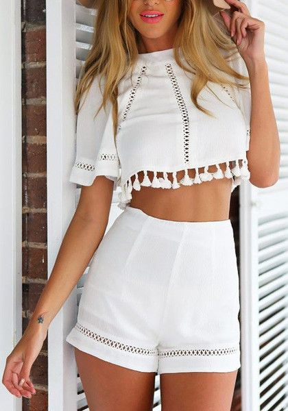 This white tassel shorts co-ord set is a combination of a crop top and shorts. The top features tassel design at the bottom with partially cutout detailing and zip closure at back. While the bottom shorts has back zip closure. | Lookbook Store What's New