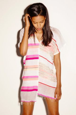 Mix you beach look up with the super fun Amash Split Coverup!