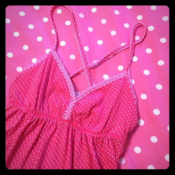 "Hollister tank Cute baby doll fit tank with a contrasting print and stripes along the bust/straps. Straps cross in the back. Tagged a small but I'm thinking it fits more like an extra small! Gently worn, no flaws to note. Bust: about 12"" though it can stretch, length: about 22.5"" Hollister Tops Tank Tops"
