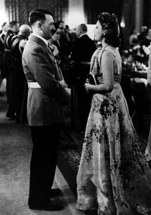 Adolf Hitler with a well dressed woman at a reception at the Reich Chancellery