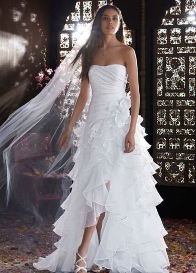 Stunning Strapless Organza High Low Ruffle Skirt Gown Style Ultra chic and over the top this strapless organza gown is perfect for any true fashionista bride