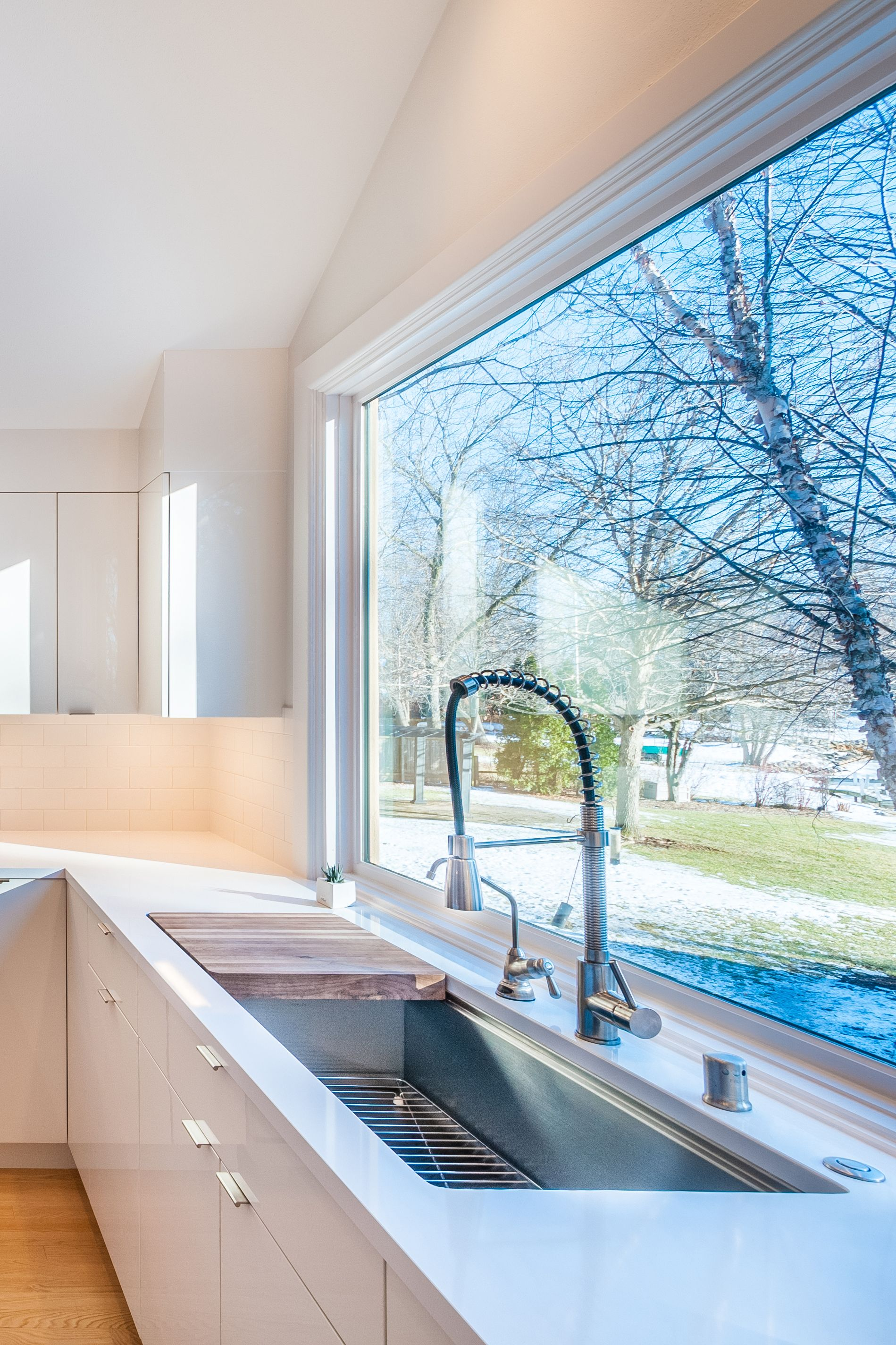 The 45 Kohler Stages Sink Was Incorporated Into This White Modern Kitchen With Images White Modern Kitchen Modern Kitchen Kitchen And Bath Design