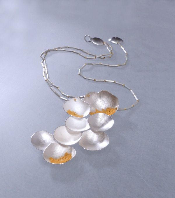Archipielago Collection. Argentium sterling silver, poliester painted mesh and silk thread.