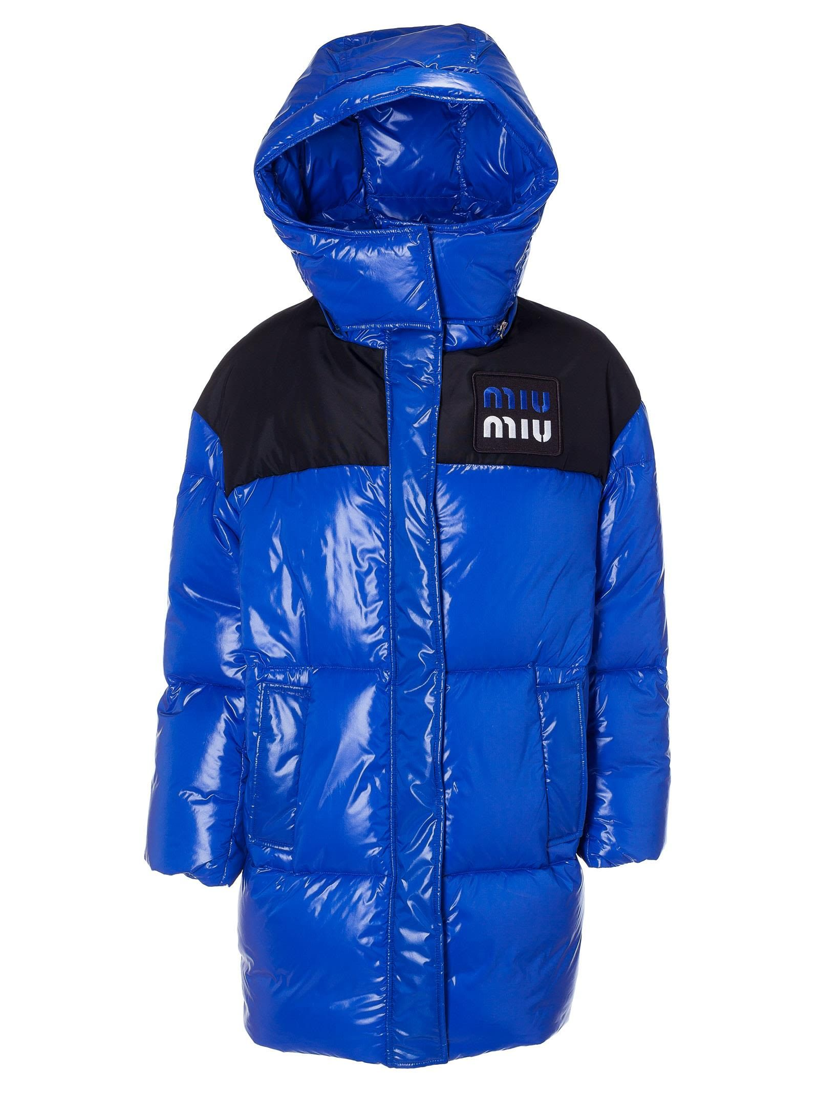 e2c9f12c2d0 Best price on the market at italist. Miu Miu - Miu Miu Long Quilted Long  Logo Patch Padded Jacket - Bluette