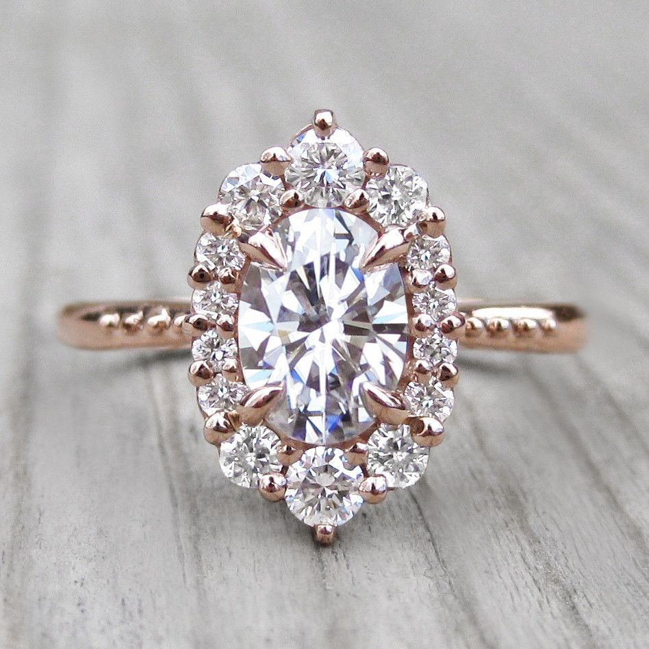Oval forever one moissanite engagement ring with diamond halo