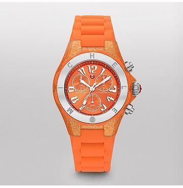 Tahitian Jelly Bean, Orange Glitter  Tahitian Jelly Beans by MICHELE feature a dose of playful luxury in an irresistible range of colors. With a chronograph movement, bolder dial size, and a sporty strap and bezel, these timepieces are as undeniably fun as they are luxurious.
