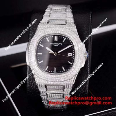 Replica Patek Philippe Nautilus Watch Silver Iced Out Case Black Dial