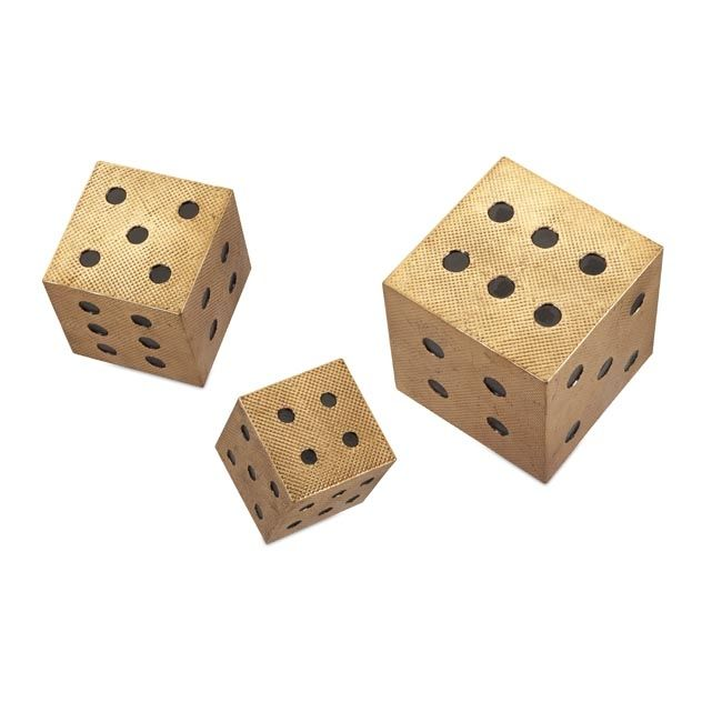 Beth Kushnick Hanging Wall Dice - Set of 3 - Create a playful wall accent with this set of three gold metal dice. Comes with hangers on reverse. Designed by Beth Kushnick.