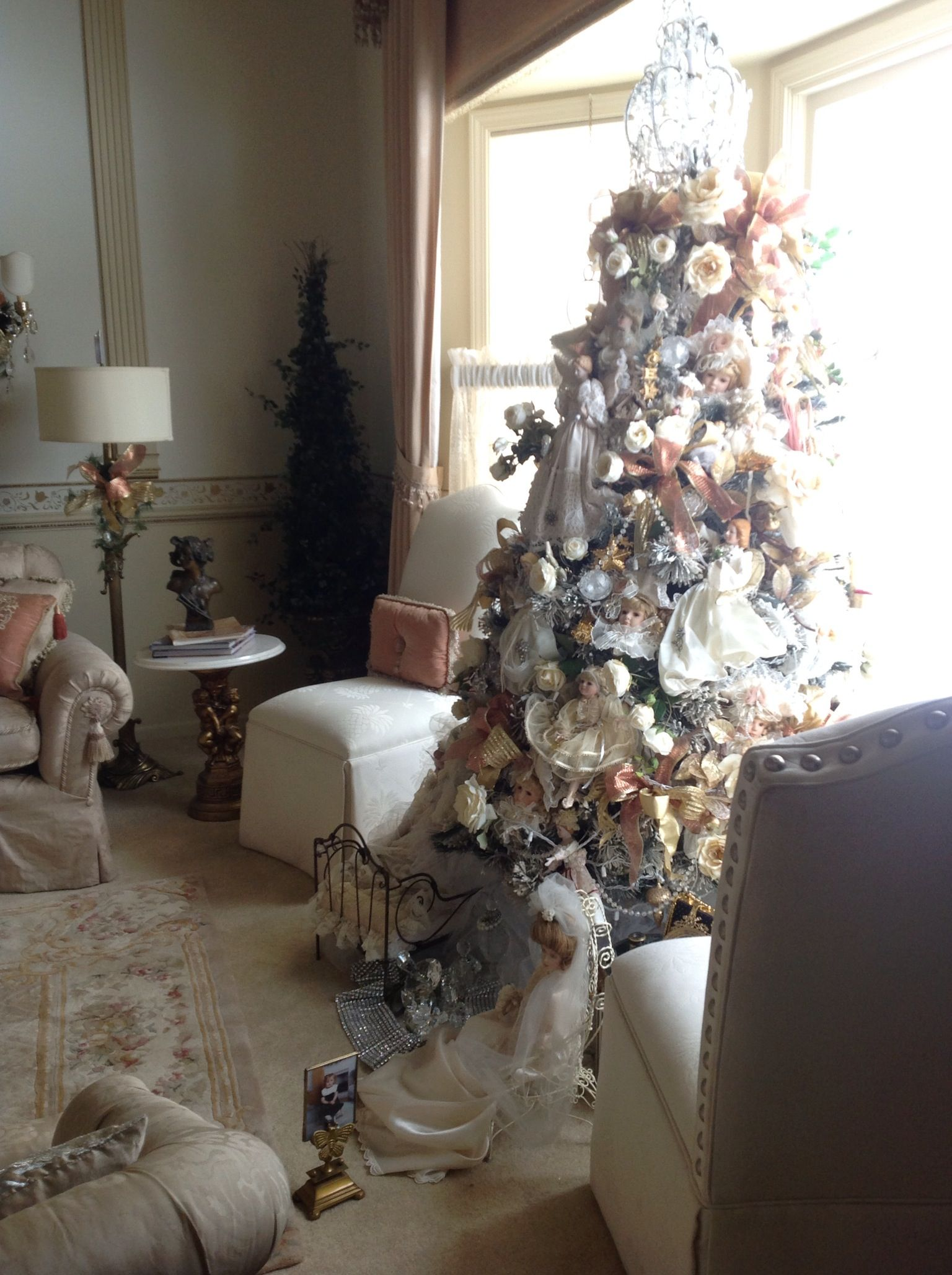 Living room white flocked christmas tree trimmed chandelier living room white flocked christmas tree trimmed chandelier tree top old dolls arubaitofo Gallery