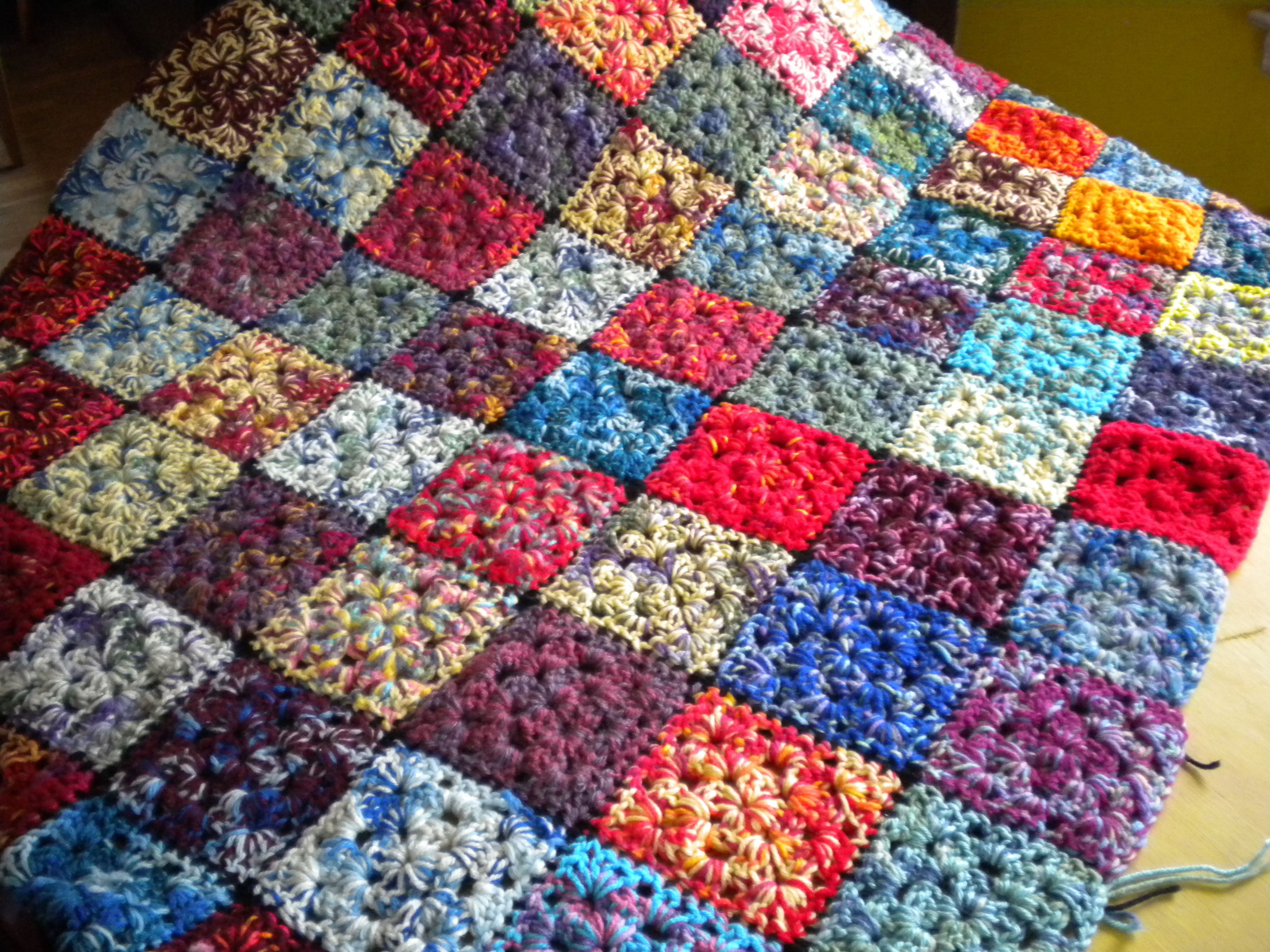 Beautiful variegated yarn granny square afghan ~ looks like a quilt ...