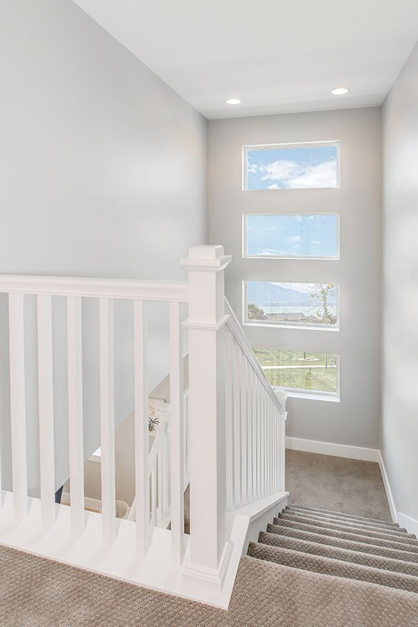 Every extra window adds a little extra sunlight. Staircase design ...