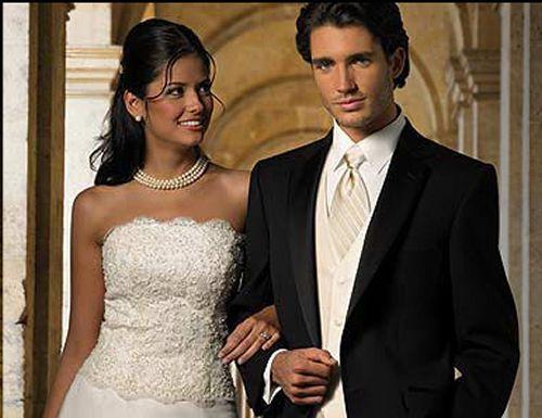 Groom Looks Wedding In Black Tux