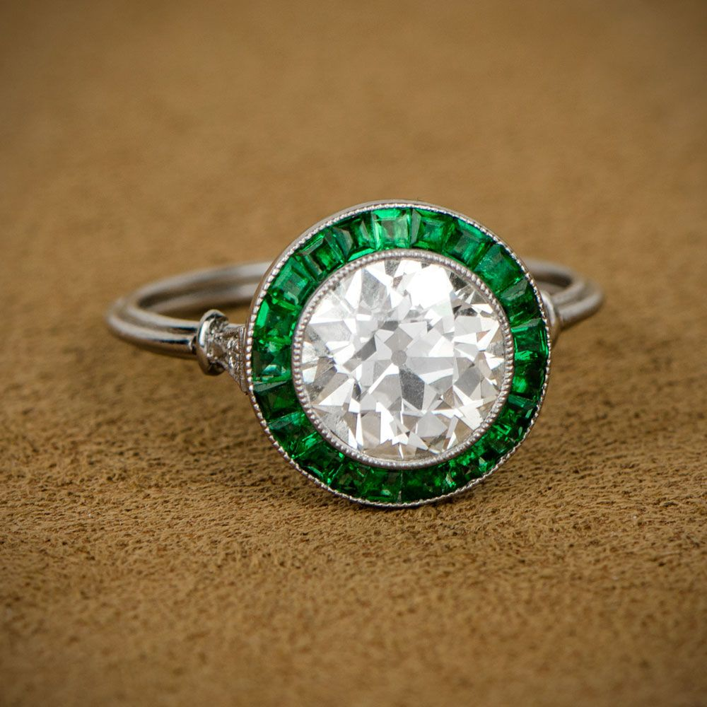 28cdce2b5 A beautiful old european cut diamond, surrounded by a stunning halo of  French-cut emeralds. Sold by Estate Diamond Jewelry